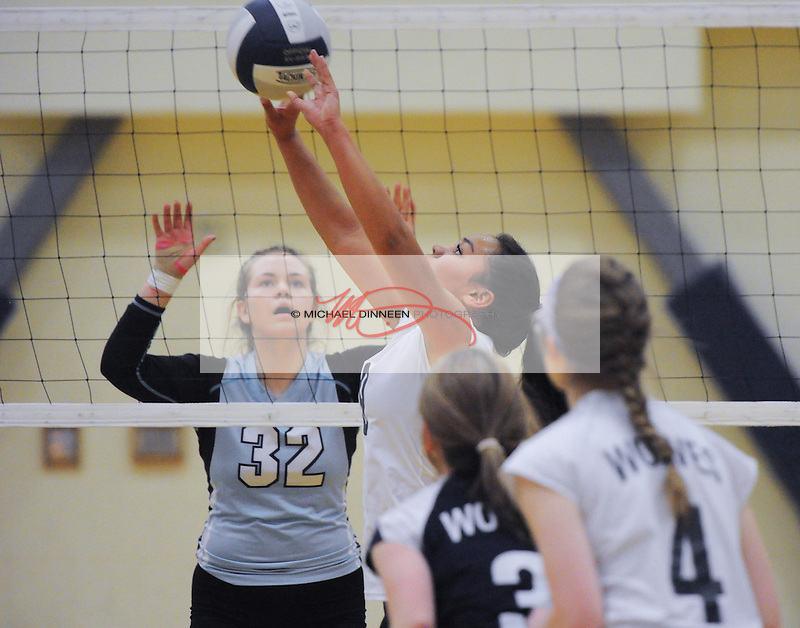 Eagle River's Genna Graf sets the ball in front of Chugiak's Claire Schimmck at Eagle River High School Wednesday, October 26, 2016. Photo for the Star by Michael Dinneen