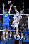 LOS ANGELES - MAY 5:  Kyle Ensing #5 of the Long Beach State 49ers spikes the ball against Christian Hessenauer #17 of the UCLA Bruins during the Division 1 Men's Volleyball Championship on May 5, 2018 at Pauley Pavilion in Los Angeles, California. The Long Beach State 49ers defeated the UCLA Bruins 3-2. (Photo by John W. McDonough/NCAA Photos via Getty Images)