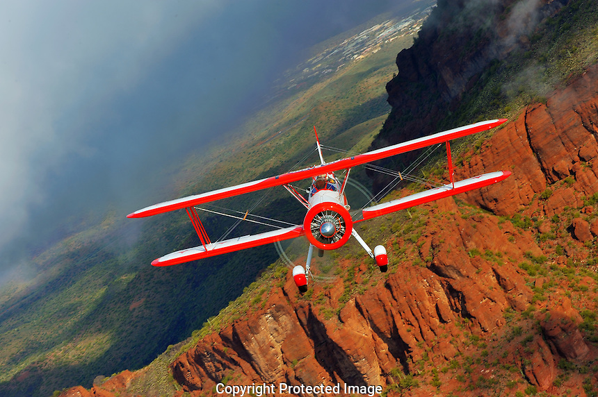 Boeing Stearman passes over Arizona's Superstition Mountains
