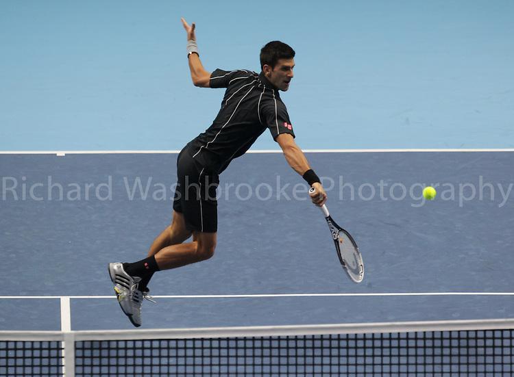 Barclays ATP World Tour Finals 2013<br /> Novak Djokovic (SRB) beat Roger Federer (SUI)  6:4  6:7  6:2<br /> <br /> Tuesday 5th November 2013<br /> <br /> Photo: Richard Washbrooke Sports Photography<br /> Barclays ATP World Tour Finals 2013<br /> <br /> Tuesday 5th November 2013<br /> <br /> Photo: Richard Washbrooke Sports Photography