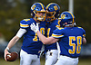 Matthew Sluka #10, Kellenberg quarterback, left, gets congratulated by Robert Filshie #81, center, and Sean Foley #58 after running 36 yards for a touchdown on the Firebirds' first play from scrimmage in the NYCHSFL Class AA final against Xavier (Manhattan) at Mitchel Athletic Complex in Uniondale on Saturday, Nov. 17, 2018. Sluka totaled five touchdowns (three rushing, two passing) with 111 yards on the ground and 111 yards in the air to lead his team to a 41-6 win.
