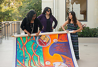 From left, Bianca Fonseca Cervantes '14, Highland Park artist Pola Lopez and Jacqueline Ayala '14 show the finished Educational Empowerment Mural before installation in the Academic Commons on May 6, 2014. (Photo by Marc Campos, Occidental College Photographer)
