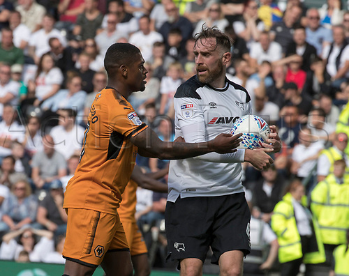 12th August 2017, Derby, England ; EFL Championship league football Derby County versus Wolverhampton Wanderers; Ivan Cavaleiro of Wolves tries to grab the ball from Richard Keogh of Derby County after scoring the second goal for Wolves