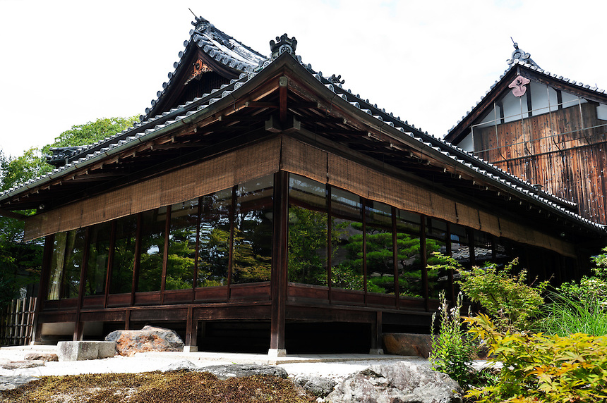 Tenjuan's lush gardens reflect in the pavilion's windows at Nanzenji Temple, Kyoto