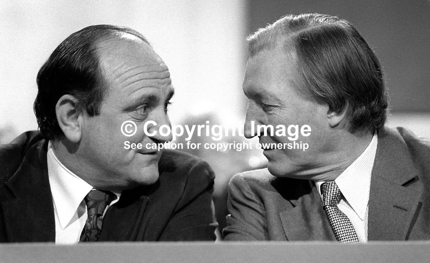 Charles Haughey, TD, Prime Minister, Taoiseach, Rep of Ireland, right, chatting with his Minister for Justice, Gerry Collins, on the platform at the Fianna Fail Ard Fheis, February 1981. 198102000030CH+GC.<br /> <br /> Copyright Image from Victor Patterson,<br /> 54 Dorchester Park, <br /> Belfast, UK, BT9 6RJ<br /> <br /> t1: +44 28 9066 1296 (from Rep of Ireland 048 9066 1296)<br /> t2: +44 28 9002 2446 (from Rep of Ireland 048 9002 2446)<br /> <br /> m: +44 7802 353836<br /> <br /> e: victorpatterson@me.com<br /> www.victorpatterson.com<br /> <br /> Please see my Terms and Conditions of Use at www.victorpatterson.com. It is IMPORTANT that you familiarise yourself with them.<br /> <br /> Images used on the Internet must be visibly watermarked i.e. &copy; Victor Patterson<br /> within the body of the image and copyright metadata must not be deleted. Images <br /> used on the Internet have a size restriction of 4kbs and will be chargeable at current<br />  NUJ rates unless agreed otherwise.<br /> <br /> This image is only available for the use of the download recipient i.e. television station, newspaper, magazine, book publisher, etc, and must not be passed on to any third <br /> party. It is also downloaded on condition that each and every usage is notified within 7 days to victorpatterson@me.com<br /> <br /> The right of Victor Patterson to be identified as the author is asserted in accordance with The Copyright Designs And Patents Act (1988). All moral rights are asserted.