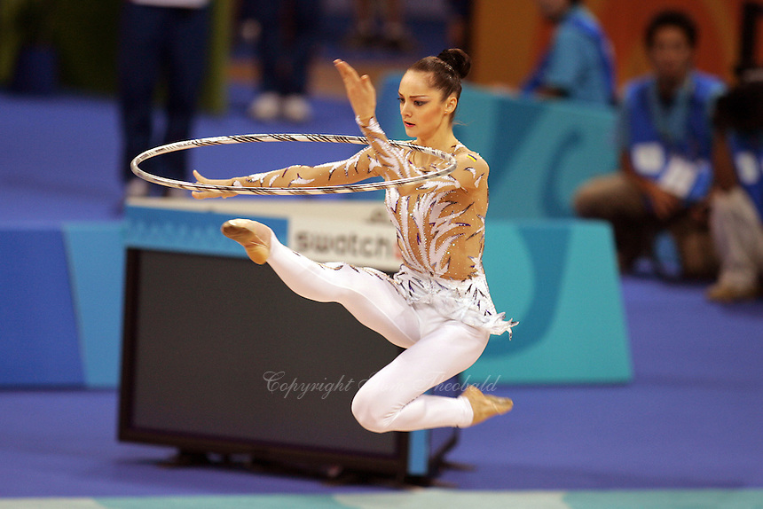 Anna Bessonova of Ukraine cossack leaps with hoop during qualifications round at 2004 Athens Olympic Games on August 26, 2006 at Athens, Greece. (Photo by Tom Theobald)