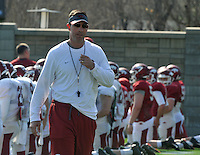 NWA Democrat-Gazette/Michael Woods --03/31/2015--w@NWAMICHAELW... University of Arkansas offensive coordinator Dan Enos works with his team during Tuesday afternoons practice in Fayetteville.
