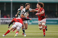 Joe Munro of Ealing Trailfinders looks for a way past Sebastian Jewell of London Welsh (left) and Benjamin Pienaar of London Welsh (right) during the Greene King IPA Championship match between Ealing Trailfinders and London Welsh RFC at Castle Bar , West Ealing , England  on 26 November 2016. Photo by David Horn / PRiME Media Images