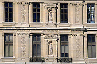 Sculpted facade of the Louvre Museum, Paris, France.