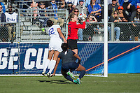Cary, North Carolina - Sunday December 6, 2015: Penn State Nittany Lions goalie Britt Eckerstrom (28) makes a save in front of teammate Elizabeth Ball (7) and Kayla McCoy (12) of the Duke Blue Devils during second half action at the 2015 NCAA Women's College Cup at WakeMed Soccer Park.  The Nittany Lions defeated the Blue Devils 1-0.