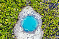 aerial view of a remote island with a shallow blue hole, Raja Ampat Islands, West Papua, Indonesia, Pacific Ocean