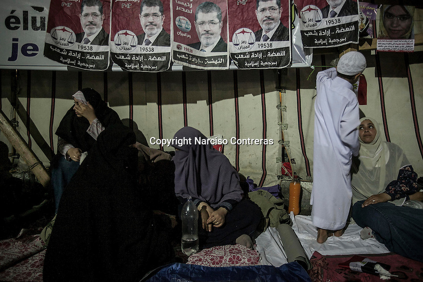In this Wednesday, Jul. 24, 2013 photo, supporters of the ousted president Mohammed Morsi gather during a speech in the nearby streets to Al-Rabaa mosque in the Nasr City neighbourhood of Cairo. (Photo/Narciso Contreras).