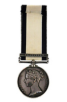 BNPS.co.uk (01202 558833)<br /> Pic:PeterWilsonAuctioneers/BNPS<br /> <br /> Auctioneers expect a high price for this poignant item of Nelsonian history...<br /> <br /> The service medal awarded to one of the men who carried a mortally wound Lord Nelson down from the deck where he was shot to his deathbed has emerged for sale for £30,000.<br /> <br /> Able Seaman James Sharman was 20 years old when he served on the HMS Victory during the Battle of Trafalgar on October 21, 1805.<br /> <br /> After Nelson was shot by an eagle-eyed French sniper in the rigging, he helped carry him down to the Orlop deck.<br /> <br /> Sharman was also the inspiration for the Charles Dickens' character Ham Peggotty in his 1850 novel David Copperfield, after the famous author read about his heroic rescue of a crew member from a sea disaster.<br /> <br /> Sharman's Naval Service Medal, with a Trafalgar clasp, is being sold with auction house Peter Wilson, of Nantwich, Cheshire.