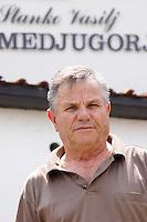 Vasilj Stanko, the owner and winemaker standing in front of the winery, restaurant and auberge: Vinarija Stankela Stanko winery, Medugorje, near Mostar. Medjugorje. Federation Bosne i Hercegovine. Bosnia Herzegovina, Europe.