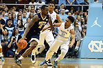 14 February 2016: Pittsburgh's Michael Young (left) is defended by Joel Berry II (right) and Kennedy Meeks (behind). The University of North Carolina Tar Heels hosted the University of Pittsburgh Panthers at the Dean E. Smith Center in Chapel Hill, North Carolina in a 2015-16 NCAA Division I Men's Basketball game. UNC won the game 85-64.