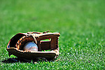 8 March 2010: A baseball glove lies on the grass infield prior to a Spring Training game between the Florida Marlins and the Washington Nationals at Space Coast Stadium in Viera, Florida. The Marlins defeated the Nationals 12-2 in Grapefruit League action. Mandatory Credit: Ed Wolfstein Photo