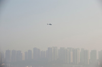 Daytime Landscape View Of A Helicopter Flying Over The Yangtze River In Chongqing, China.  © LAN
