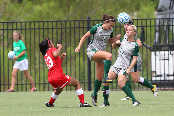 Denton, TX - AUGUST 31: Kara Brooks #14 and Molly Grisham #6 of the North Texas Mean Green soccer in action  against University of Houston Cougars at the Mean Green Village Soccer Field on August 31, 2012 in Denton, Texas. NT won 2-1.(Photo by Rick Yeatts)