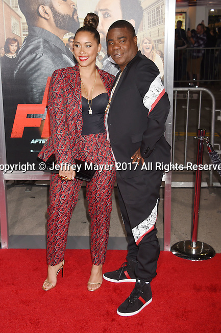 HOLLYWOOD, CA - FEBRUARY 13: Actress Megan Wollover (L) and actor/comedian Tracy Morgan attend the premiere of Warner Bros. Pictures' 'Fist Fight' at the Regency Village Theatre on February 13, 2017 in Westwood, California.