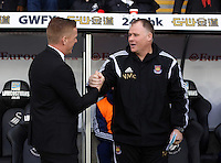 Pictured L-R: Swansea manager Garry Monk greets the West Ham stand-in manager  Saturday 10 January 2015<br />