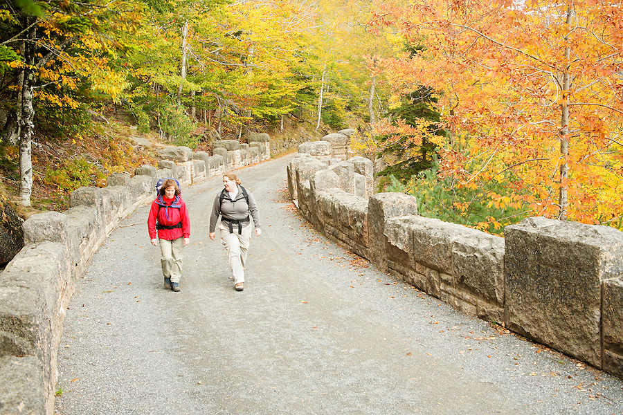 Women walking carriage road, Acadia National Park, Hancock County, Maine, USA
