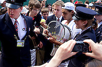 Rafael Nadal mobbed by fans after practice at Wimbledon..Tennis - Wimbledon Lawn Tennis Championships - Day 13 Sun 4th Jul 2010 -  All England Lawn Tennis and Croquet Club - Wimbledon - London - England..© FREY - AMN IMAGES  Level 1, Barry House, 20-22 Worple Road, London, SW19 4DH.TEL - +44 (0) 20 8947 0100.Email - mfrey@advantagemedianet.com.www.advantagemedianet.com