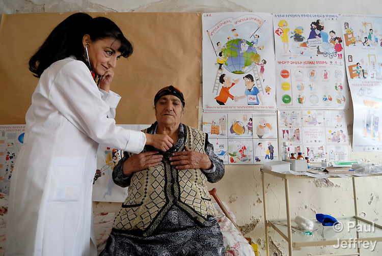 Dr. Tamara Tovmasyan, a TB specialist, examines Arax Pogmosyan in a clinic in Lernanist, Armenia, supported by the United Methodist Committee on Relief..