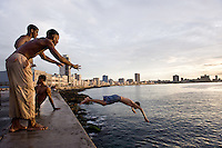 Boys swimming at the Malecon