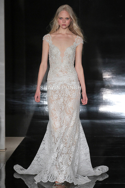 Model walks runway in a hand embroidered Chantilly lace gown with ruched skirt, from the Reem Acra Spring 2017 bridal collection, during New York Bridal Fashion Week Spring Summer 2017, on April 15, 2016.