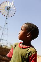 KENYA, Marsabit, village with old windmill for water pump / KENIA, Marsabit, Dorf mit alter Kleinwindanlage fuer Foerderung von Brunnenwasser