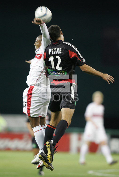 9 April 2005.  Chicago forward Andy Herron (27) goes up for a header against Mike Petke of DC United  at RFK Stadium in Washington, DC.