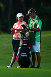 TAOYUAN, TAIWAN - OCTOBER 22: Yani Tseng of Taiwan chats with her caddie on the 15th hole during day three of the LPGA Imperial Springs Taiwan Championship at Sunrise Golf Course on October 22, 2011 in Taoyuan, Taiwan. Photo by Victor Fraile / The Power of Sport Images