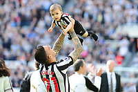 Joselu of Newcastle United throws his young son up into the air during the lap of appreciation during Newcastle United vs Chelsea, Premier League Football at St. James' Park on 13th May 2018
