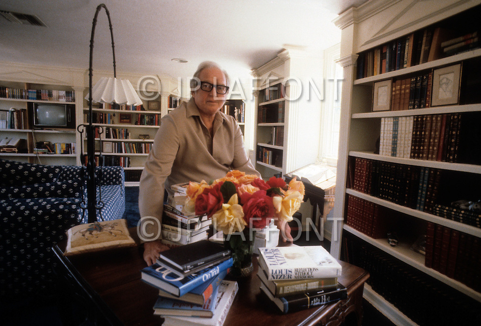 Beverly Hills, Los Angeles, Califronia - April 21, 1979. This portrait of Sidney Sheldon was taken amongst his collection of books at his home. Sidney Sheldon (1917 - 2007) was an Academy Award-winning American writer, whose vast career earned him the title of the seventh best selling writer of all time. The most well-known of his novels Master of the Game, The Other Side of Midnight and Rage Of Angels, which also became a TV series.