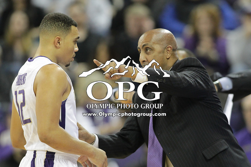JAN 1, 2016:  Washington head coach Lorenzo Romar instructs Andrew Andrews during a break in action against UCLA.  Washington defeated #25 ranked UCLA 96-93 in double overtime at Alaska Airlines Arena in Seattle, WA.