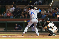 Surprise Saguaros designated hitter Charles Leblanc (12), of the Texas Rangers organization, at bat in front of catcher Matt Winn (16) and home plate umpire Alex Tosi during an Arizona Fall League game against the Scottsdale Scorpions at Scottsdale Stadium on October 15, 2018 in Scottsdale, Arizona. Surprise defeated Scottsdale 2-0. (Zachary Lucy/Four Seam Images)