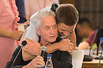 Jeremy Renner (standing) gives a hug to Michael Douglas at the China Film Makers Forum on the sidelines of the World Celebrity Pro-Am 2016 Mission Hills China Golf Tournament on 21 October 2016, in Haikou, China. Photo by Marcio Machado / Power Sport Images