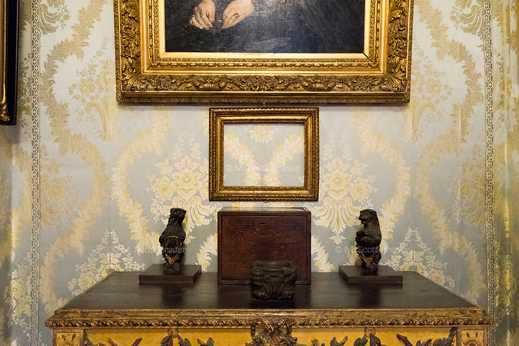 "An empty frame that once held Manet's ""Chez Tortoni"" hangs on the wall in The Blue Room of the Isabella Stewart Gardner Museum in Boston, Mass., USA, on Tues., Dec. 5, 2017. The painting was one of 13 objects stolen in a 1990 heist. Hanging above the empty frame is Manet's portrait of his mother, ""Madame Auguste Manet."" Paintings by Manet, Rembrandt, Vermeer, and Degas, were stolen in the theft alongside two objects and one etching."
