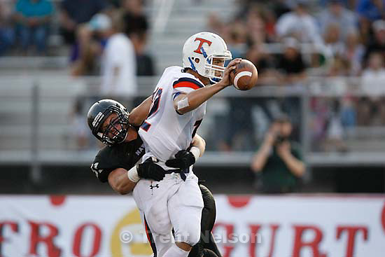 Sandy - Timpview quarterback Trevor Brown is brought down by Alta's Parker Hausknecht. Alta vs. Timpview high school football Friday, September 4 2009. .