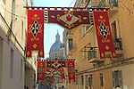 Flags decorate steep historic street in city centre of Valletta, Malta
