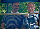 Camp David, MD - June 26, 2008 -- United States President George W. Bush (R) gives Sheikh Mohammad bin Zayed Al Nahyan the Crown Prince of Abu Dhabi, the United Arab Emirates a ride in a golf cart upon his arrival, June 26, 2008 at Camp David, Maryland. The Crown Prince is scheduled to stay over night at the presidential retreat..Credit: Mark Wilson - Pool via CNP