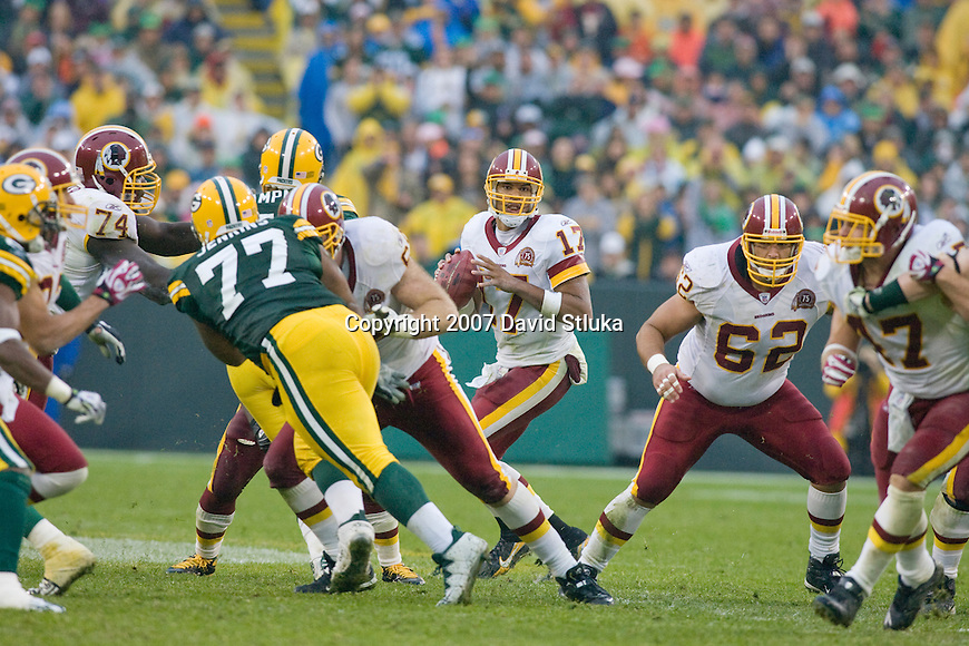 Quarterback Jason Campbell #17 of the Washington Redskins drops back to pass during an NFL football game against the Green Bay Packers at Lambeau Field on October 14, 2007 in Green Bay, Wisconsin. The Packers beat the Redskins 17-14. (Photo by David Stluka)