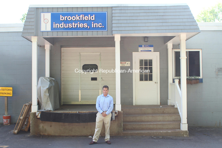 THOMASTON, CT June 26 2014-062614LW01 - Karl Kinzer, owner of Brookfield Industries, stands outside his manufacturing plant on West Hillside Avenue in Thomaston. Kinzer plans to apply for tax abatement under the new state enterprise zone in Thomaston to expand in town.<br /> Laraine Weschler Republican-American