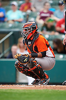 Norfolk Tides catcher Rossmel Perez (23) during a game against the Rochester Red Wings on May 3, 2015 at Frontier Field in Rochester, New York.  Rochester defeated Norfolk 7-3.  (Mike Janes/Four Seam Images)