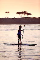 Female Paddleboarding in Newport Harbor