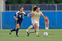 27 August 2011:  FIU's Marie Egan (13) moves the ball upfield with Akron's Rachel Phillip (12) in pursuit in the first half as the FIU Golden Panthers defeated the University of Arkon Zips, 1-0, at University Park Stadium in Miami, Florida.