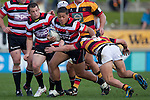 August Pulu tries to push off the Waikato tackler. ITM Cup rugby game between Waikato and Counties Manukau, played at Waikato Stadium, Hamilton on Saturday 28th August 2010..Waikato won 39 - 3.