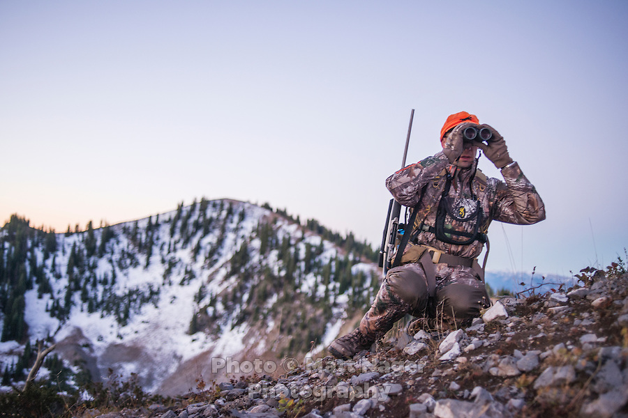 Outdoor Life Editor Andrew McKean looks through binoculars while hunting mule deer on Greyback Ridge in the Hoeback Drainage of Wyoming Region H, outside of Alpine, Wyoming, September 21, 2015.<br /> <br /> Photo by Matt Nager