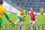 Donie O'Connor Gneeveguilla shoots for a point under pressure from Mark Reen Rathmore during their O'Donoghue cup semi final in Fitzgerald Stadium on Sunday