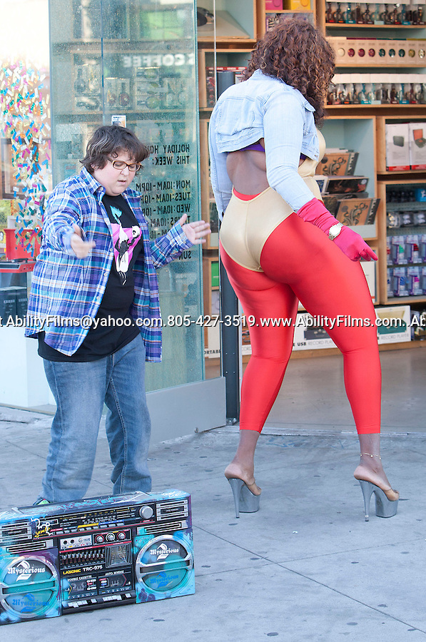 December 10th 2011...Andy Milonakis filming a music video making fun Beyonce Knowles with a big fake African American woman pretending to be her. Andy was filming on Melrose Ave in west Hollywood slapping the big ladies butt & dancing to one of Beyonce's songs. ...AbilityFilms@yahoo.com.805-427-3519.www.AbilityFilms.com..